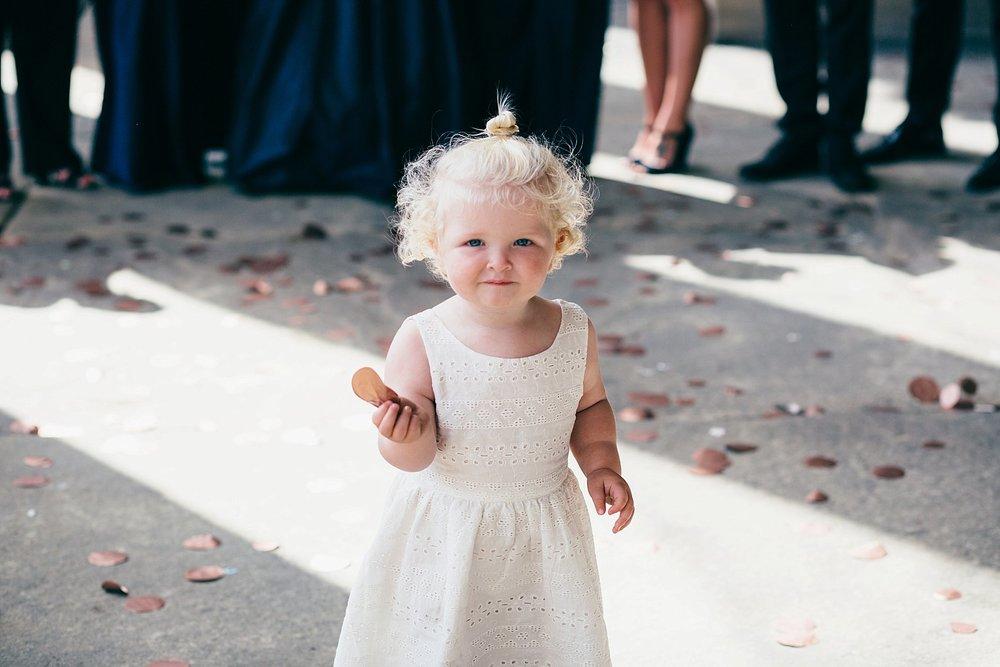 CV-294 Leeds wedding baby holding large rose gold confetti.jpg