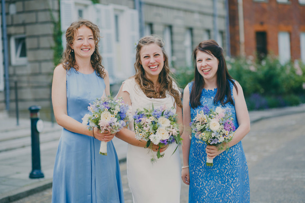 2  bride with bridesmaids cornflower blue dresses outside York House  .jpg
