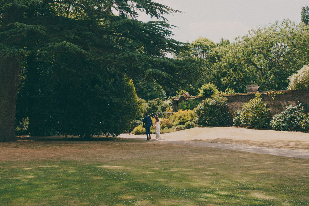 45 bride and groom walking through York House gardens.jpg