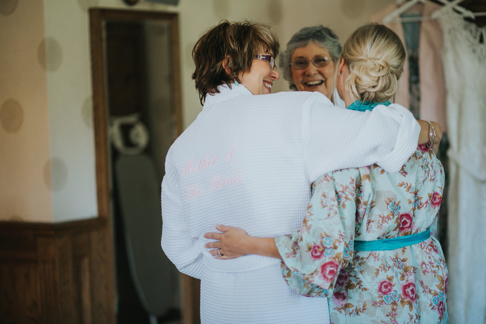 37 mother bride hugging bride moment with grandma.jpg