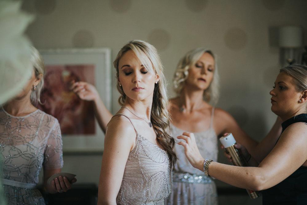 66 perfume sprayed hairspray candid wedding photo.jpg