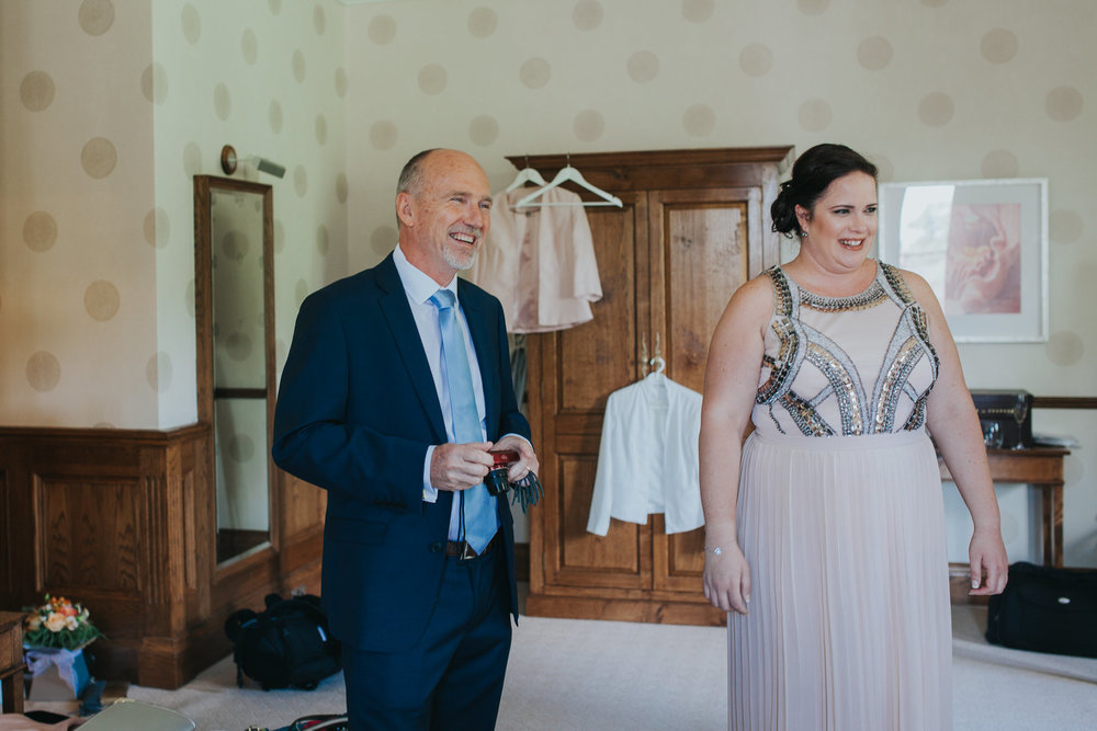 70 dad sees bride the first time wedding photojournalism.jpg
