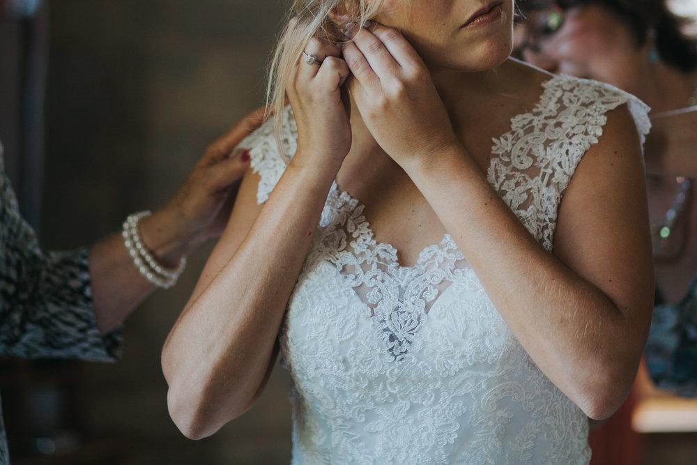 74 bride clipping earing Yolande De Vries Photography.jpg