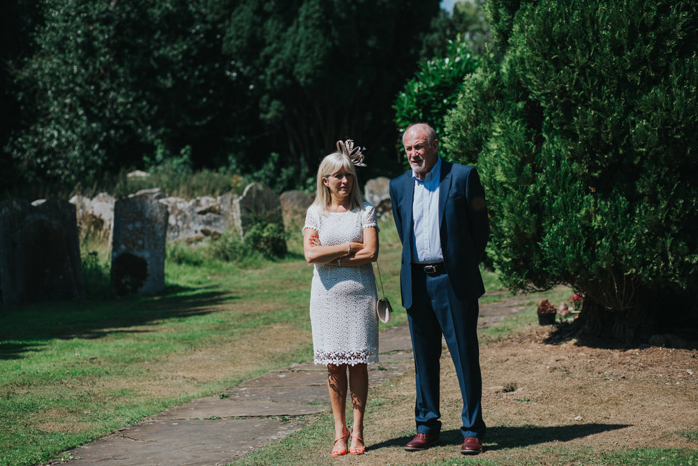 83 wedding guests arriving church sunny July Sussex.jpg