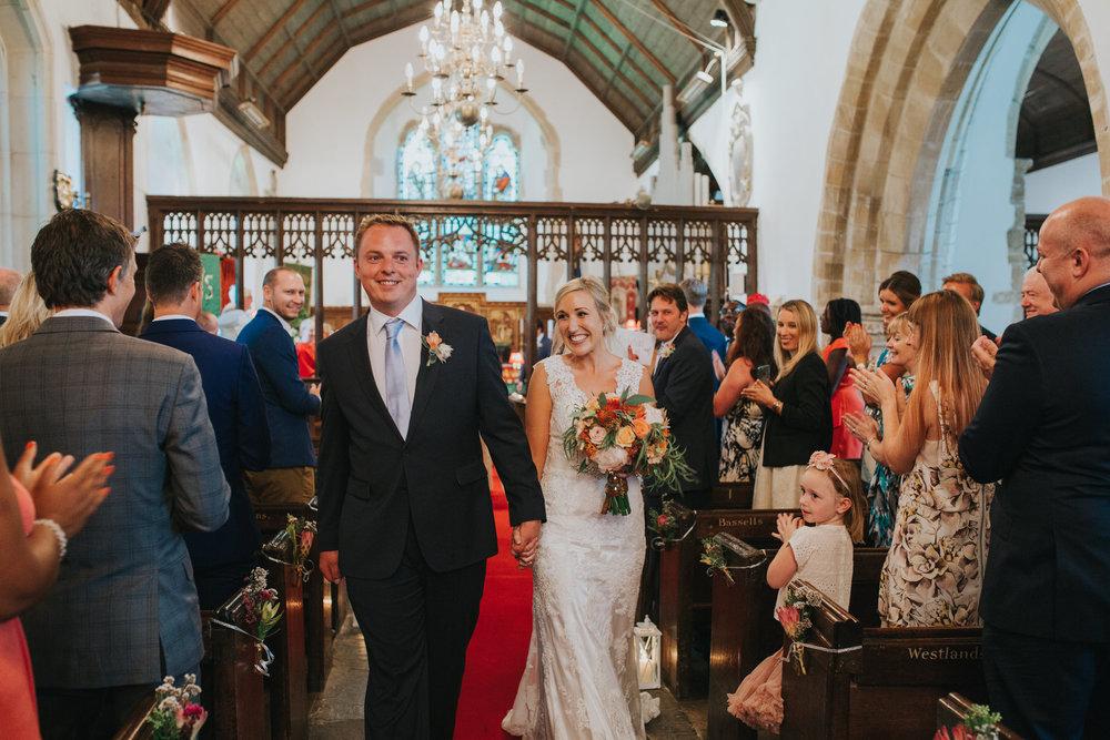 114 just married bride groom exit St Georges church West Grinstead.jpg