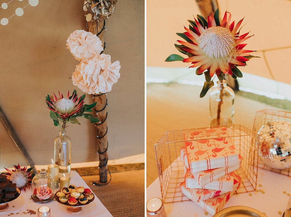 183 Knepp Castle festival tipi wedding cake table giant proteas.jpg
