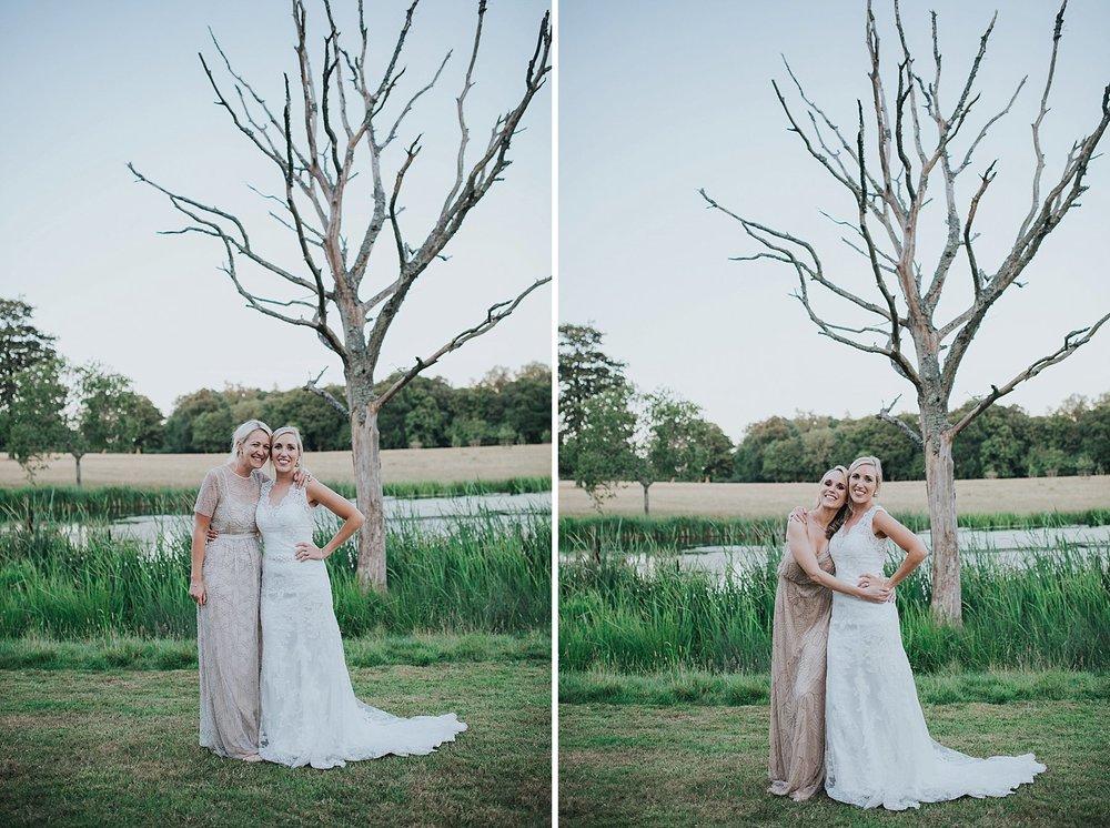 337 golden hour bride bridesmaid portraits Knepp Castle pond.jpg