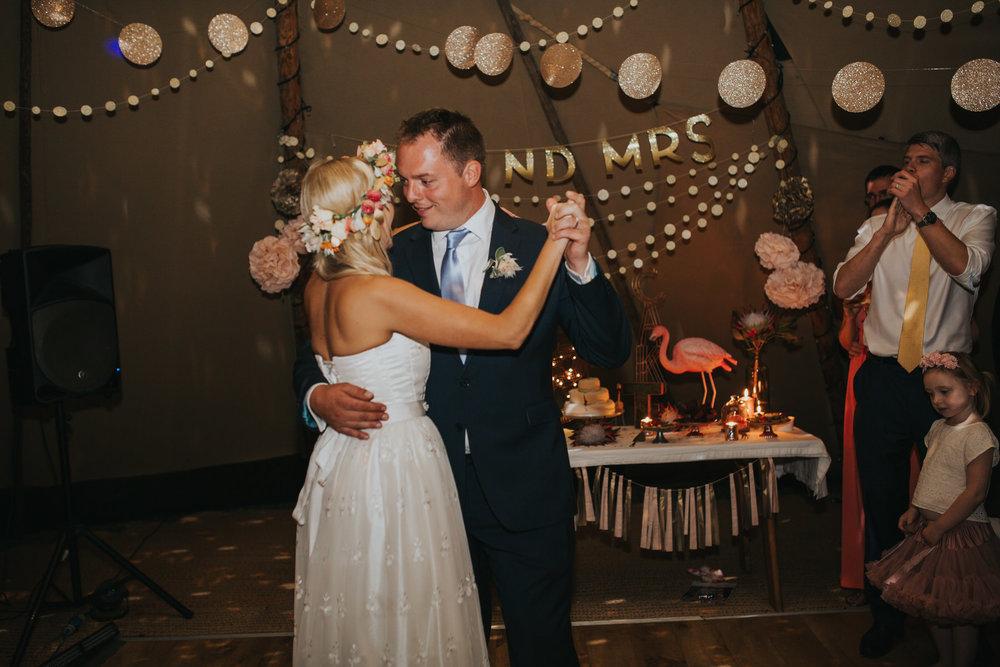 346 newly married bride groom first dance tipi wedding Knepp Castle.jpg