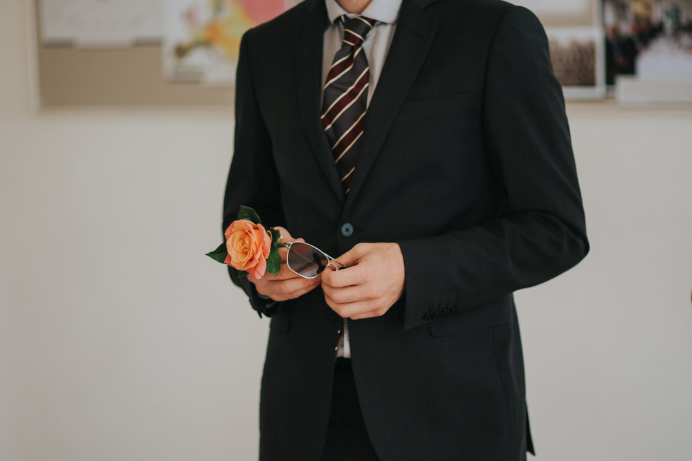 7 usher holding orange rose sunglasses Pembroke Lodge .jpg