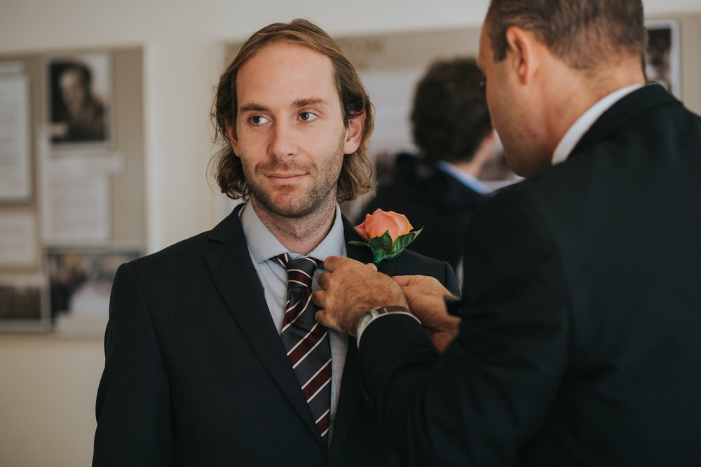 9 best man receiving buttoneire wedding ceremony.jpg
