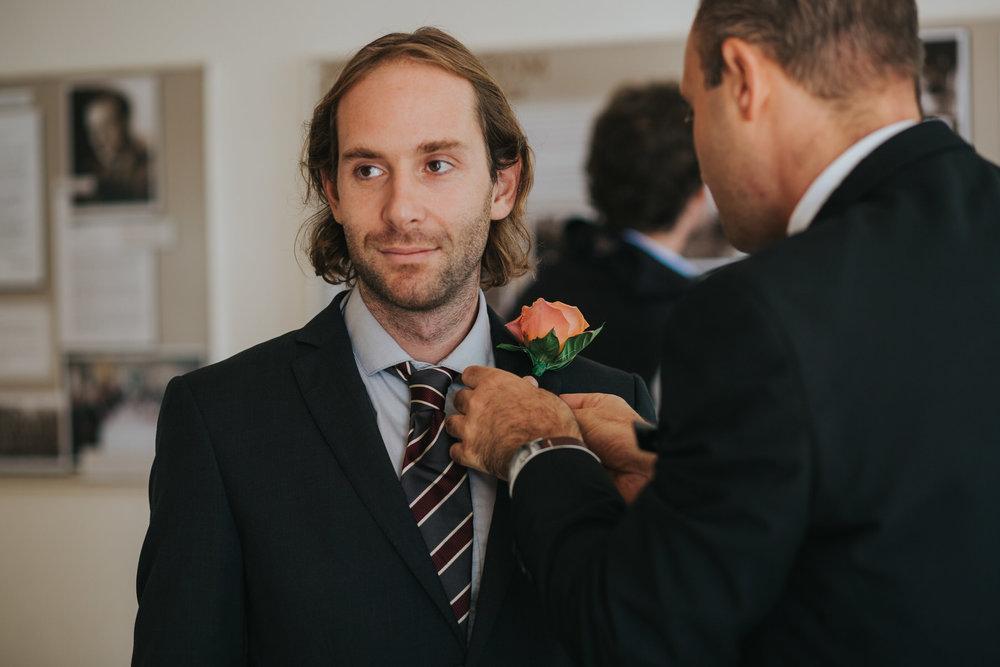 9 best man receiving buttoneire wedding ceremony.jpg