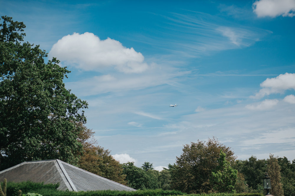 15 plane flying over Pembroke Lodge wedding.jpg