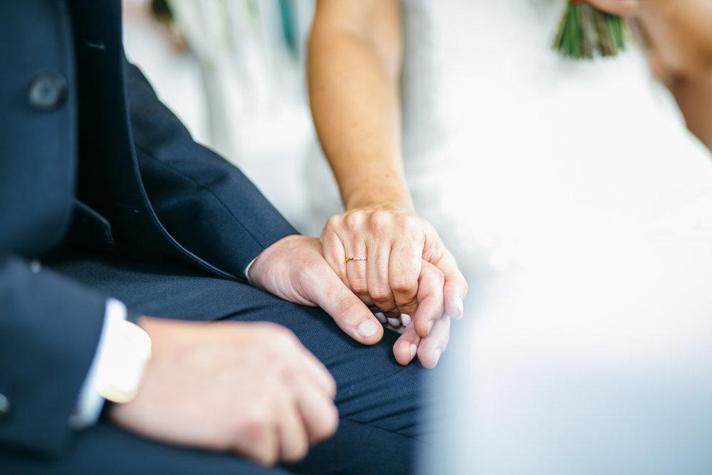 bride holding grooms hand Clissold House wedding Hackney Ceremony.jpg