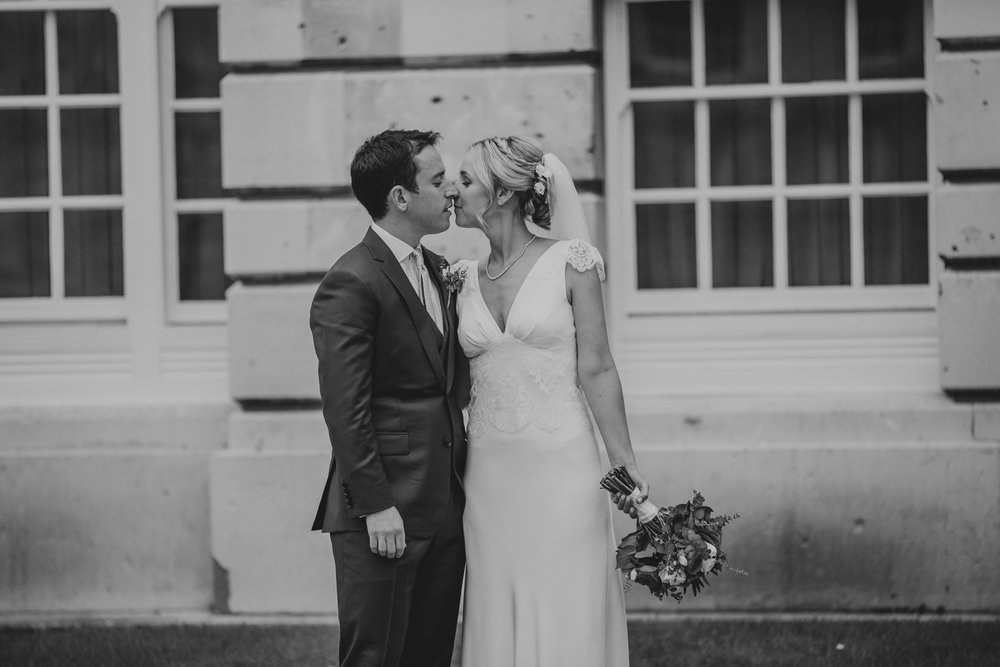 bride kissing groom Surrey County Hall wedding.jpg