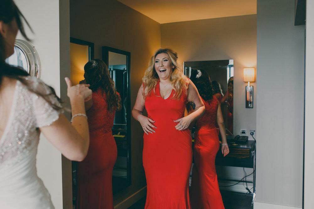 bridesmaid wearing red joy moment bride.jpg