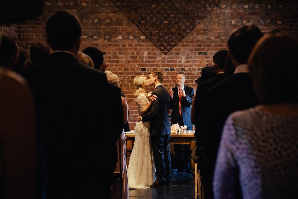 Curradine Barns Wedding bride kissing groom ceremony.jpg