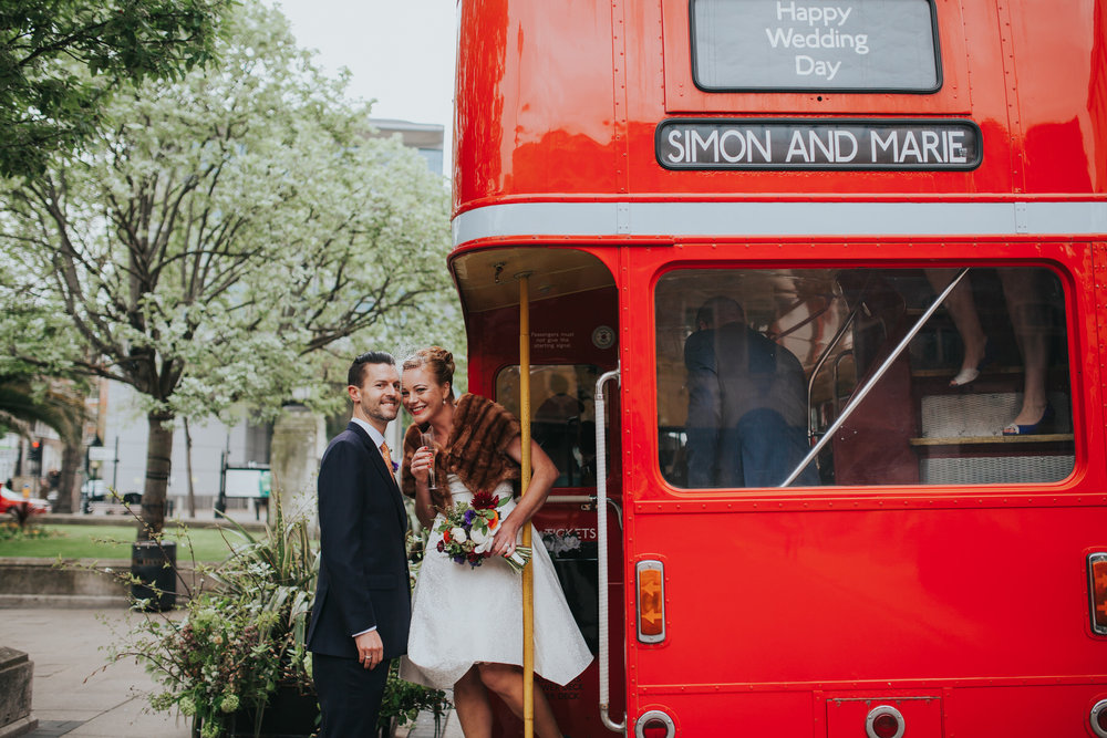 145 Hackney Town Hall wedding red bus newly married couple.jpg
