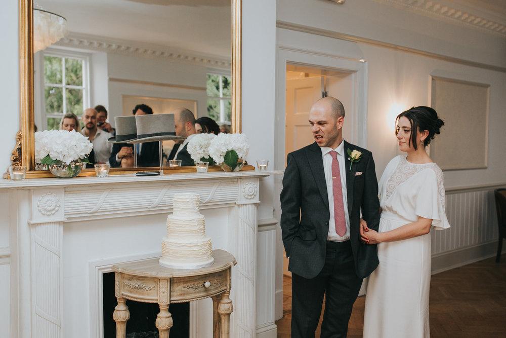 322-Belair House bride groom cut elegant minimalist cream cake.jpg
