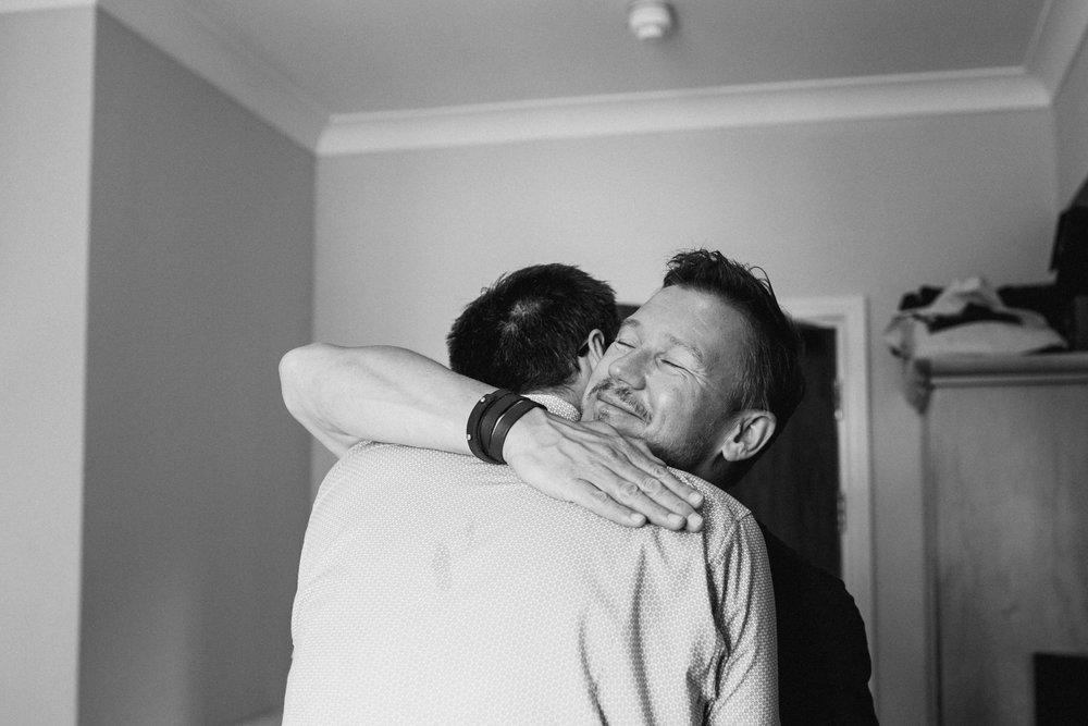 brothers hugging before wedding ceremony.jpg