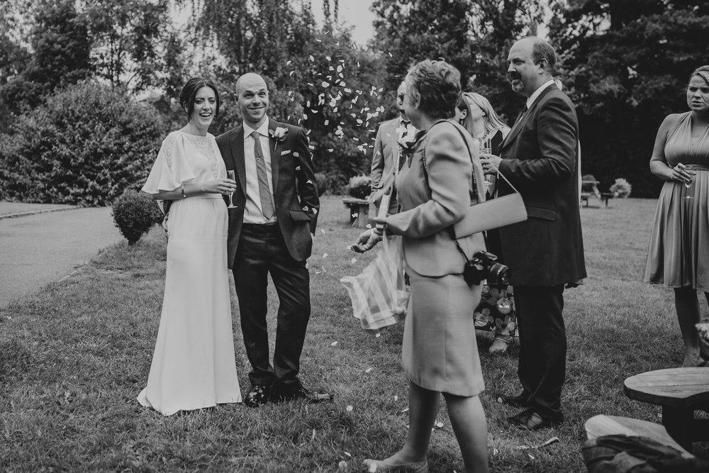 BW confetti on the lawn Belair House wedding.jpg