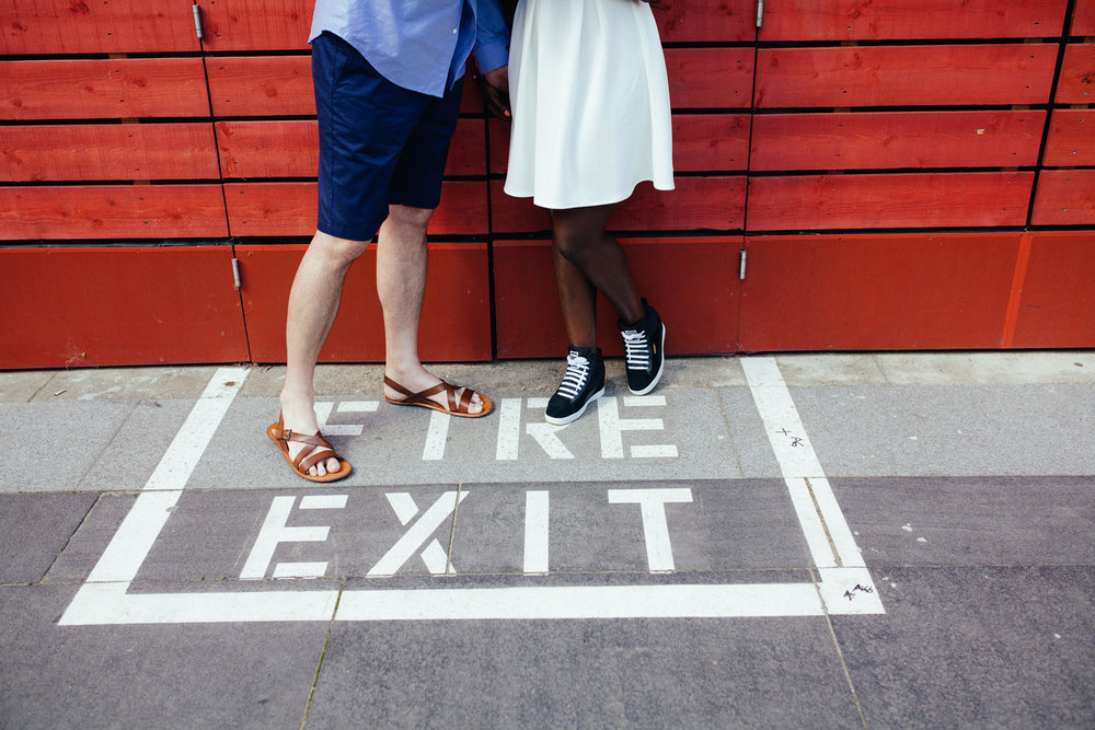 fire exit sign London Southbank engagement photographer red.jpg