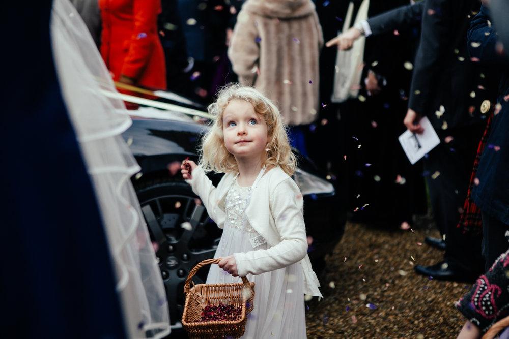 flowergirl tossing confetti documentary wedding photography.jpg