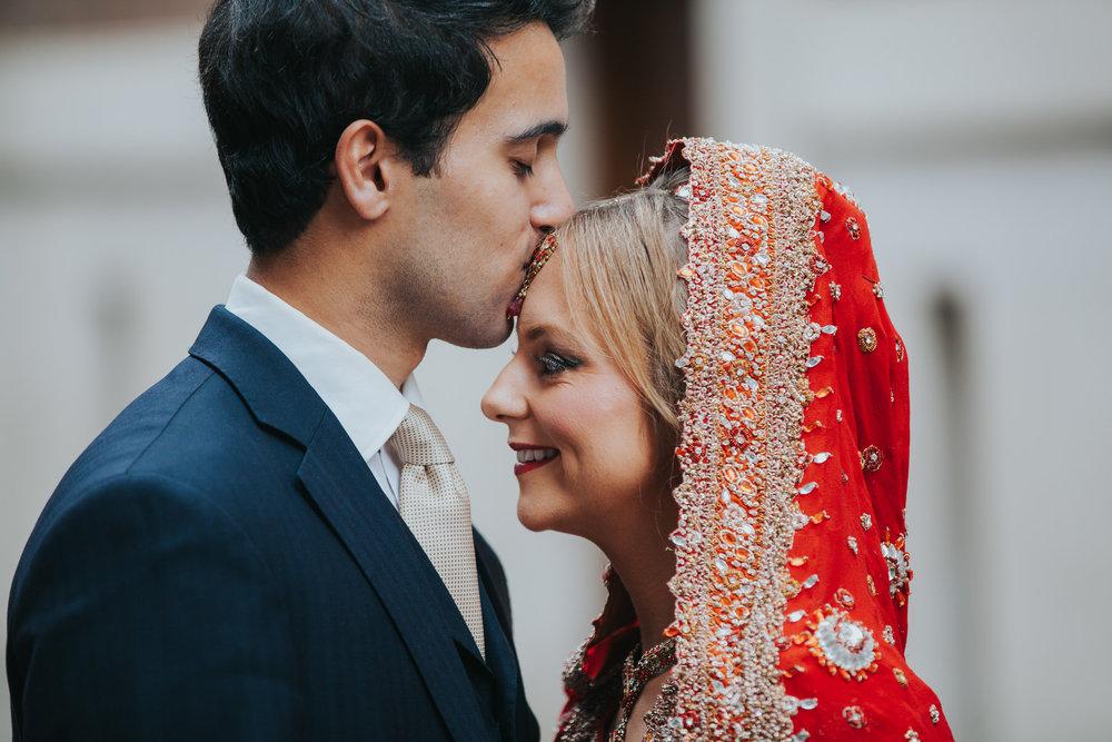 Anglo Asian London Wedding groom kissing bride forehead.jpg