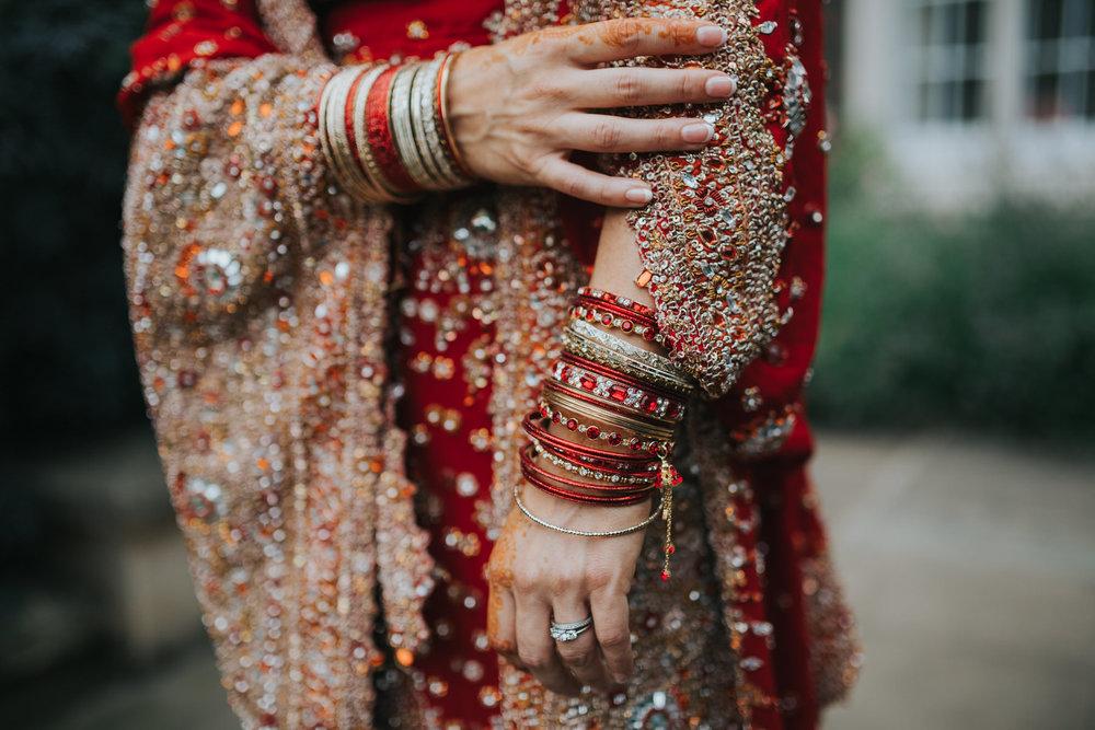 hands bride red sari henna paint.jpg