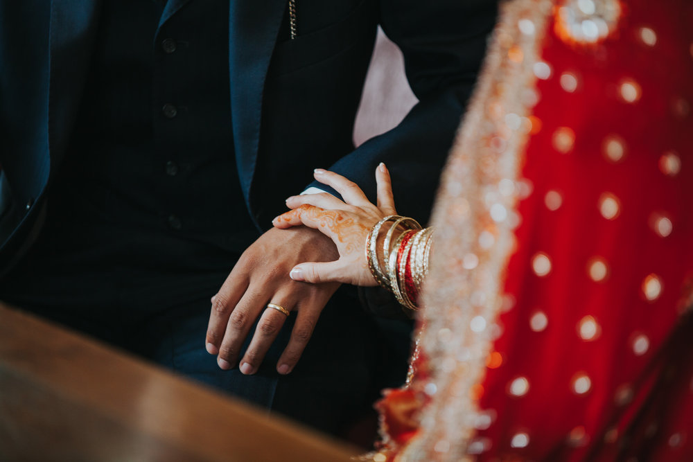 intimate hand touch Anglo-Asian London Wedding.jpg