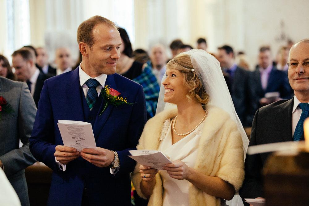 happy bride groom glance ceremony church wedding.jpg