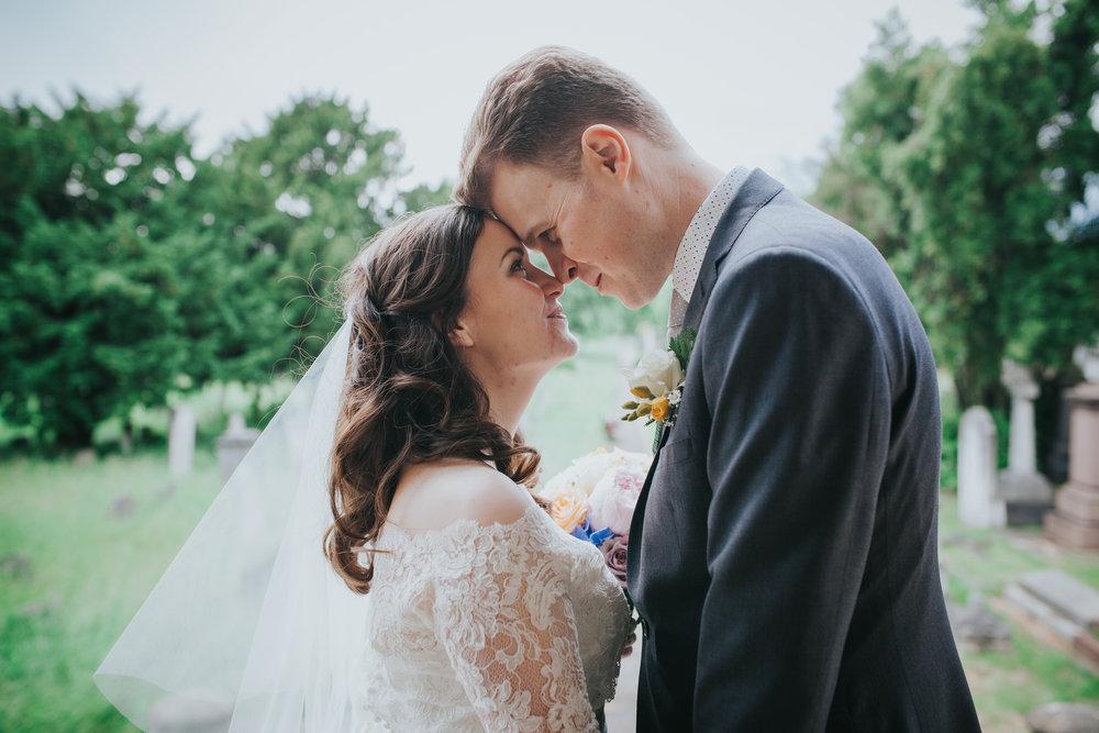 intimate moment groom bride wedding portraits Brompton Cemetery.jpg