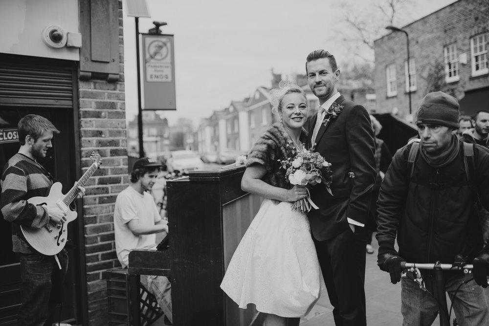 London-groom-bride-buskers Broadway-market wedding street photography.jpg