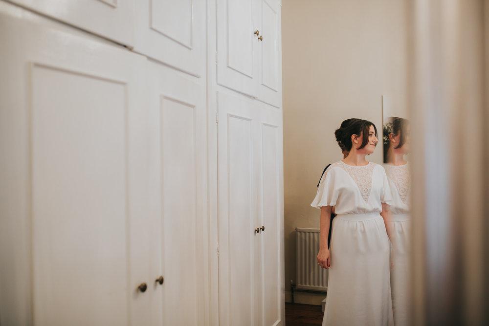 Minna wedding dress bride getting ready.jpg