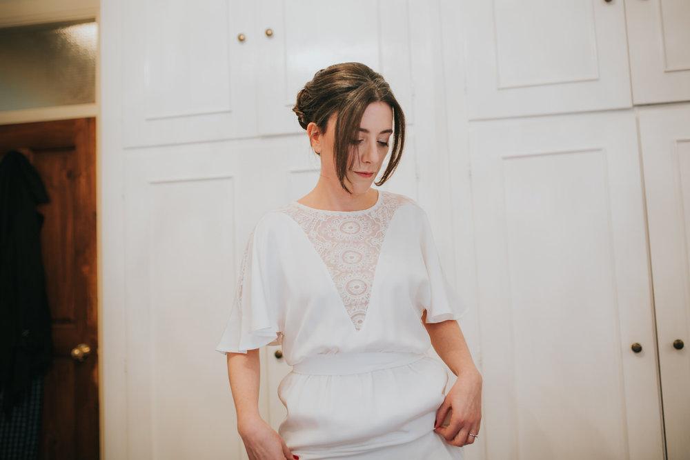 quirky bride getting ready Minna wedding dress.jpg