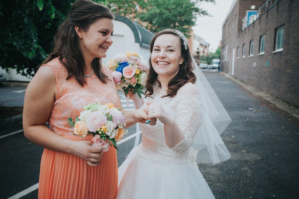 ring shot bride showing off bridesmaid sister.jpg