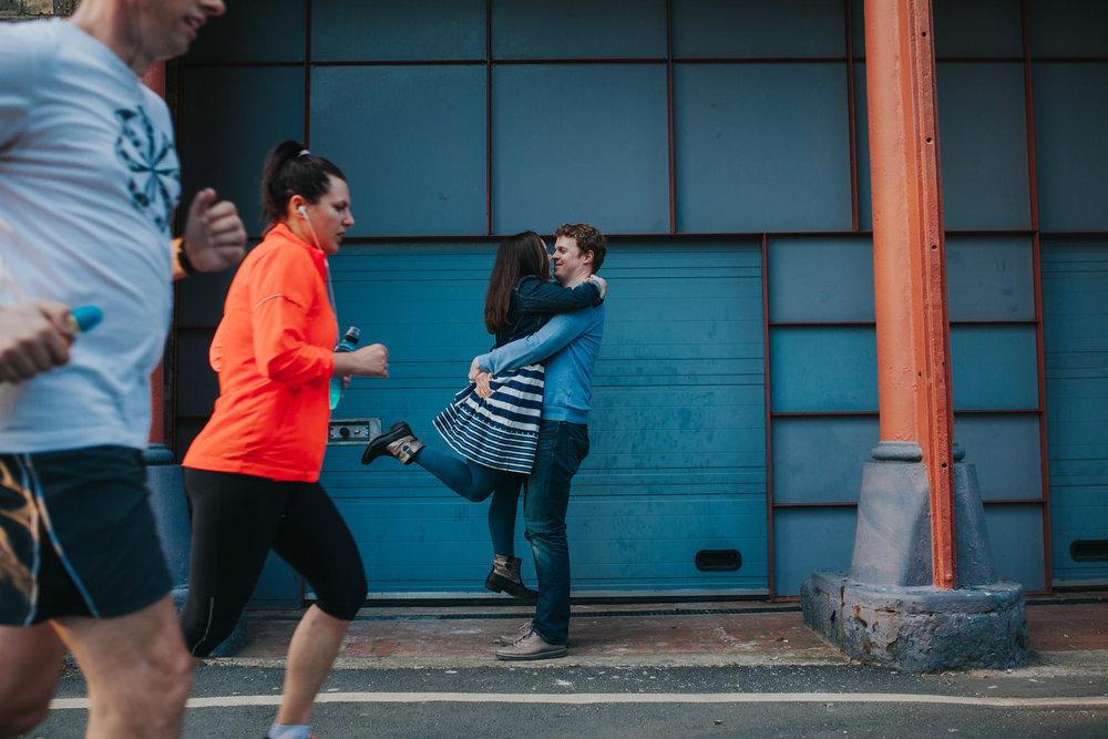 runners photobombing engagement photo London.jpg