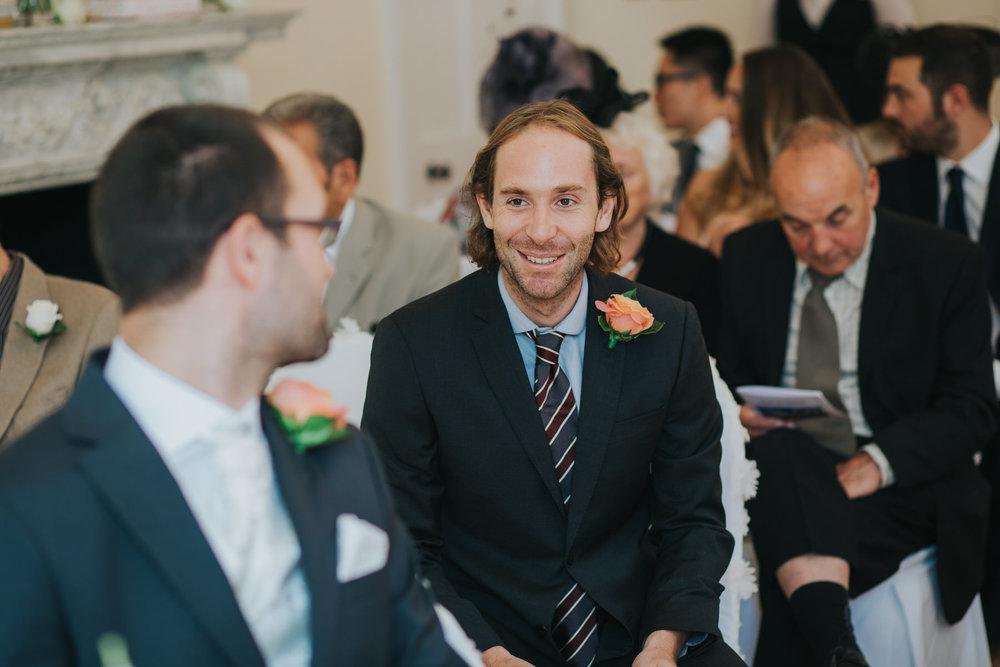 38 bestman chatting groom Pembroke Lodge wedding ceremony.jpg