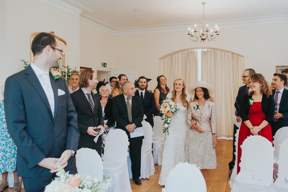 42 bride enters Russel Suite wedding ceremony.jpg