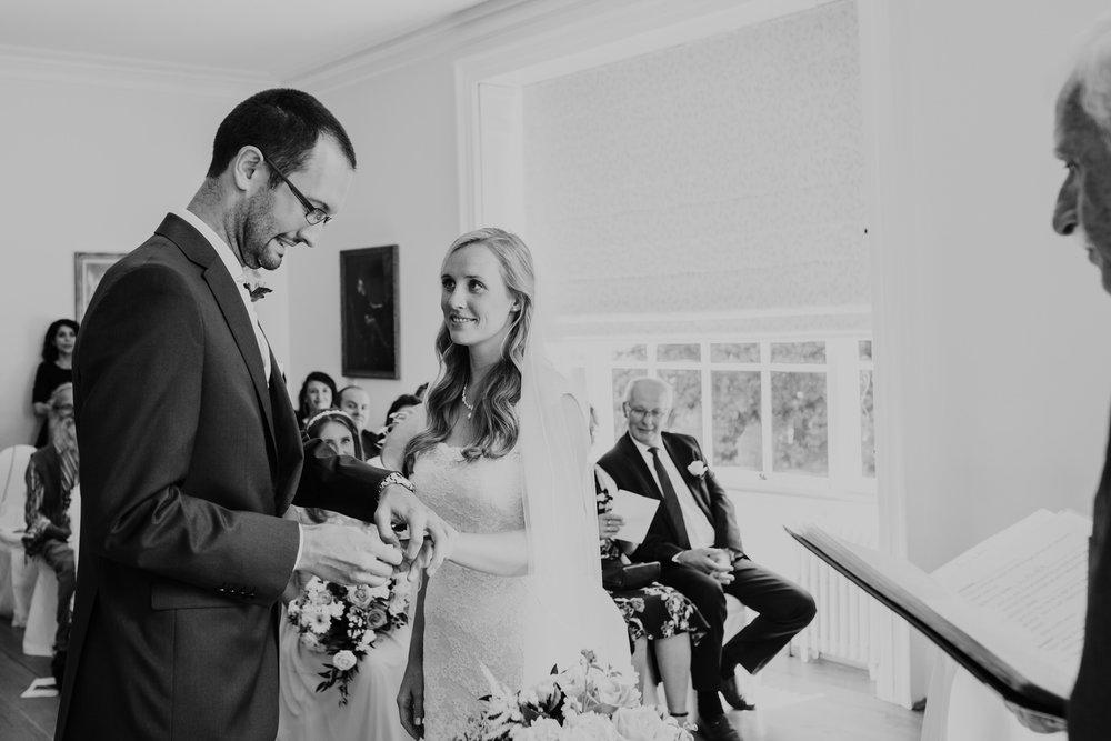 68 exchanging rings Pembroke Lodge wedding ceremony.jpg