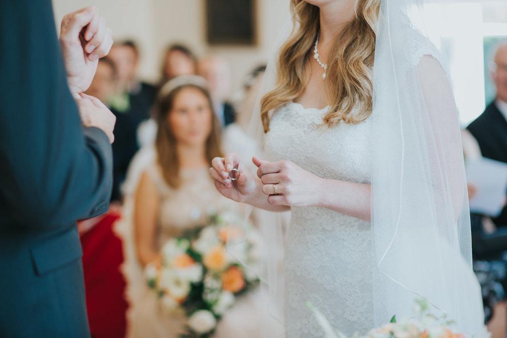 73 bride holding ring Pembroke Lodge wedding ceremony.jpg