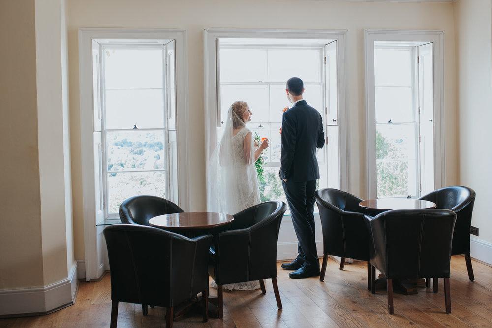92 Pembroke Lodge bride groom enjoying moment after wedding ceremony.jpg