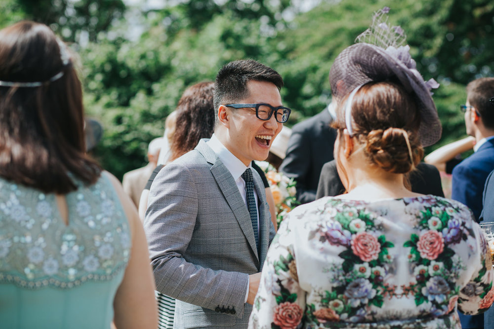 123 Pembroke Lodge South Lawn laughing guests wedding drinks reception.jpg