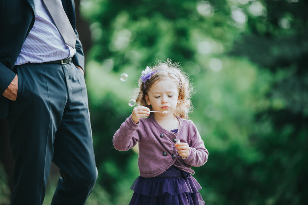 380 child blowing bubbles documentary wedding photographer.jpg