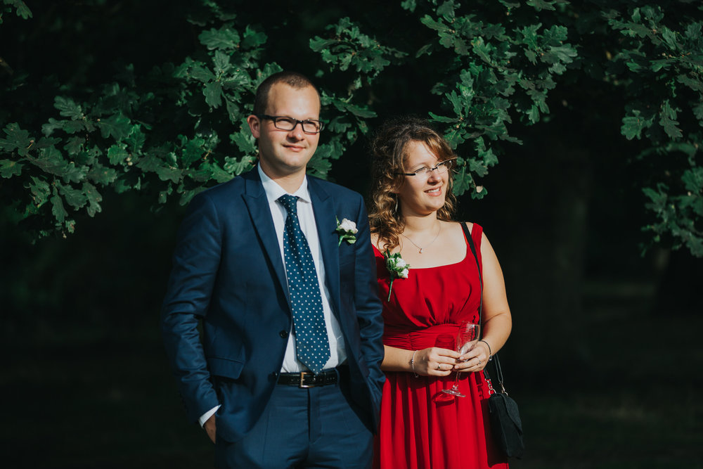 394 wedding guest in red dress reportage.jpg
