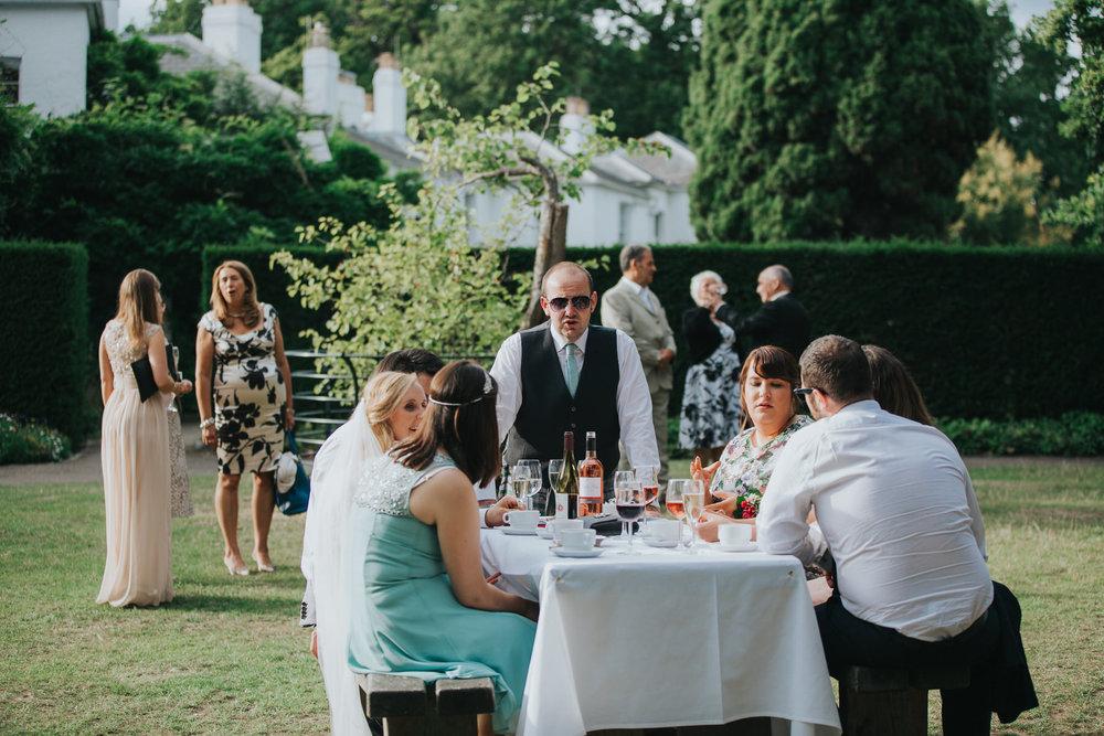 395-documentary guest candids Pembroke Lodge wedding photographer.jpg