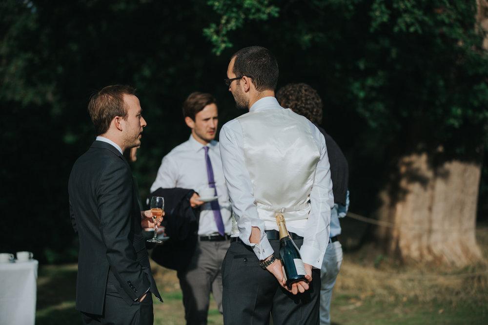 397-documentary guest candids Pembroke Lodge wedding photographer.jpg