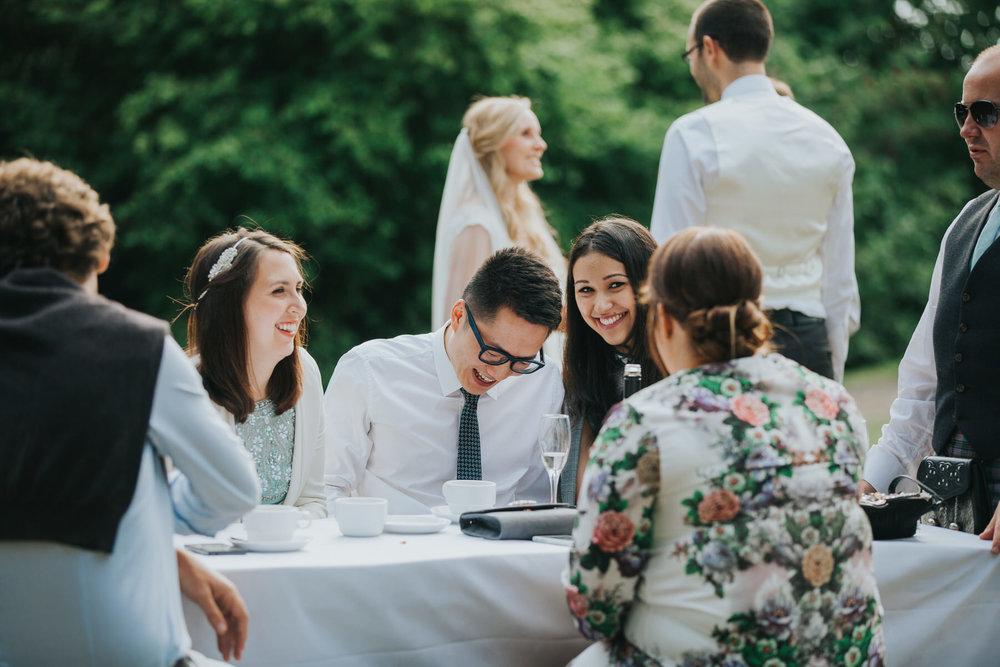 405-documentary guest candids Pembroke Lodge wedding photographer.jpg