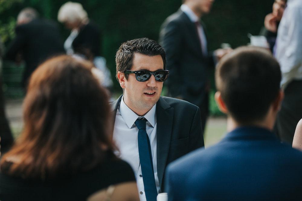 406-documentary guest candids Pembroke Lodge wedding photographer.jpg