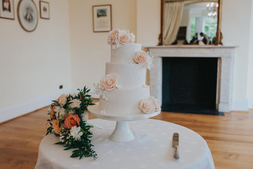 359-blush wedding cake cutting Richmond photographer.jpg