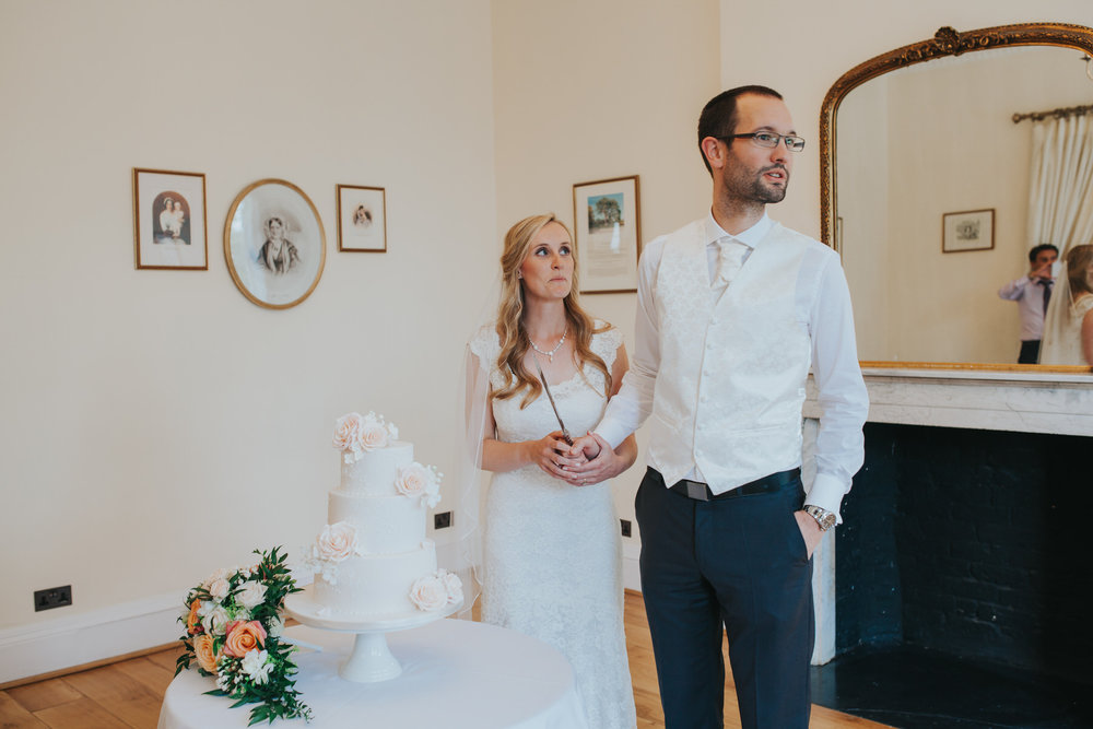 362-blush wedding cake cutting Richmond photographer.jpg